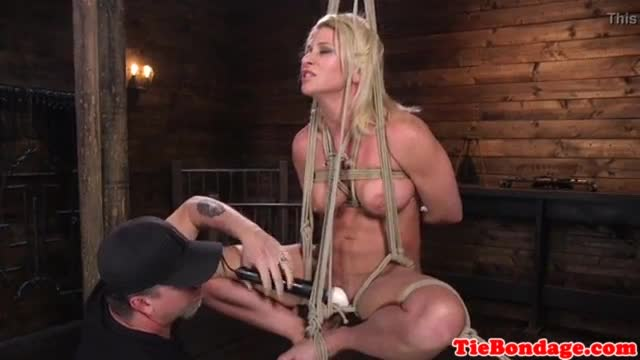 Restrained MILF gagging and gets pussytoyed